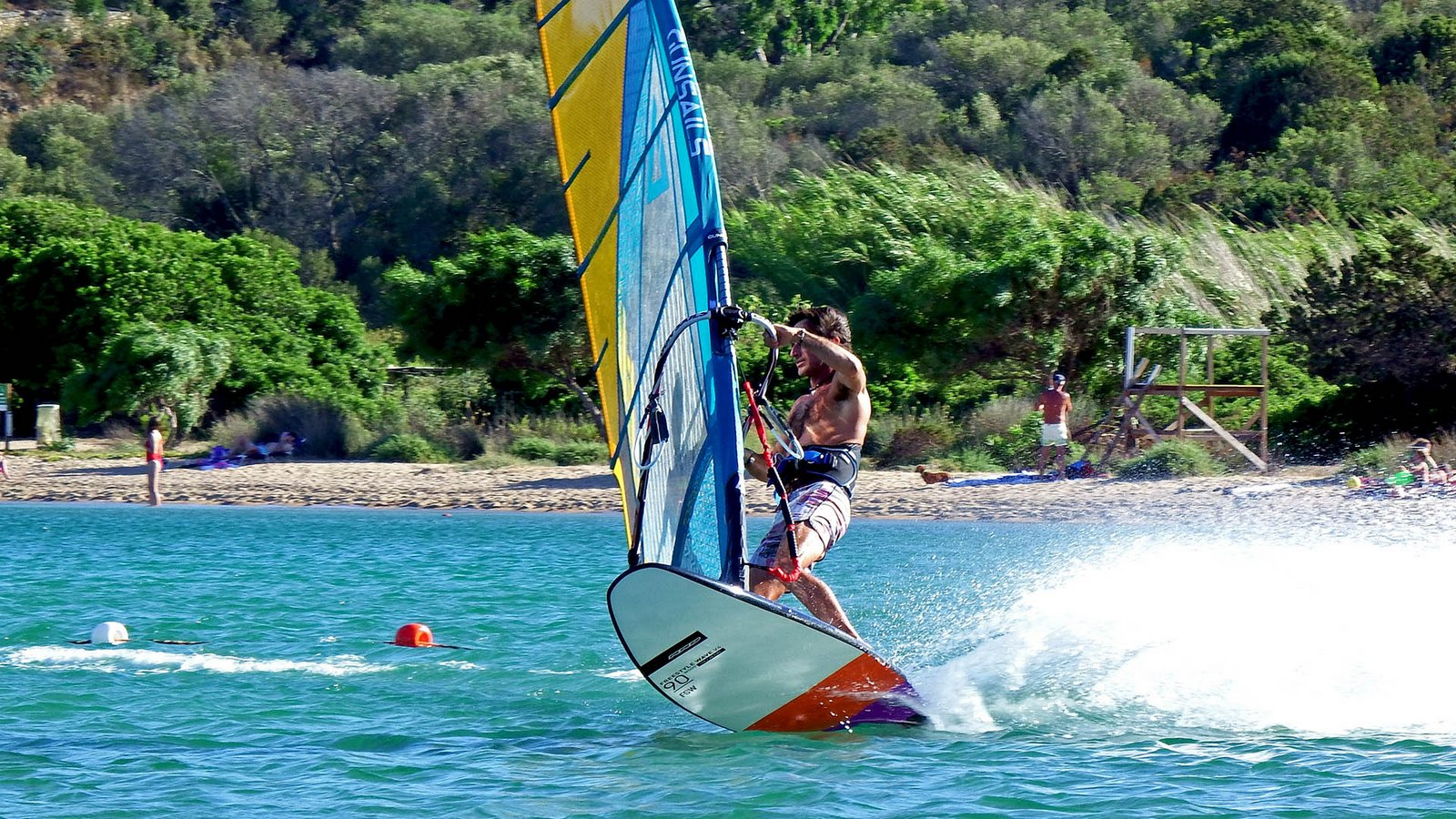 Crystal clear water and good steady wind : a windsurfer's paradise